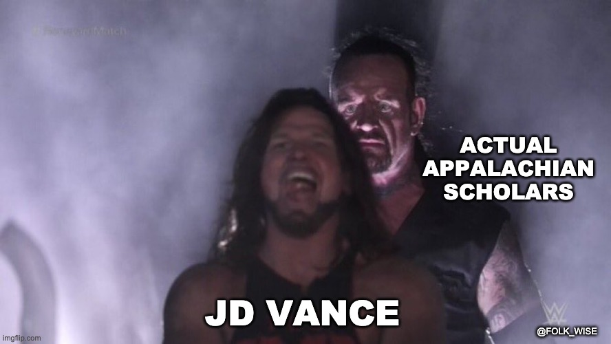 """image of two light-skinned very muscular men; wrestler AJ Styles stand in front, looking completely unassuming, while the Undertaker, standing behind him with a foreboding look, about to take him down in a fight. Text over AJ reads """"JD Vance"""" and text over the Undertaker reads """"actual Appalachian scholars."""""""