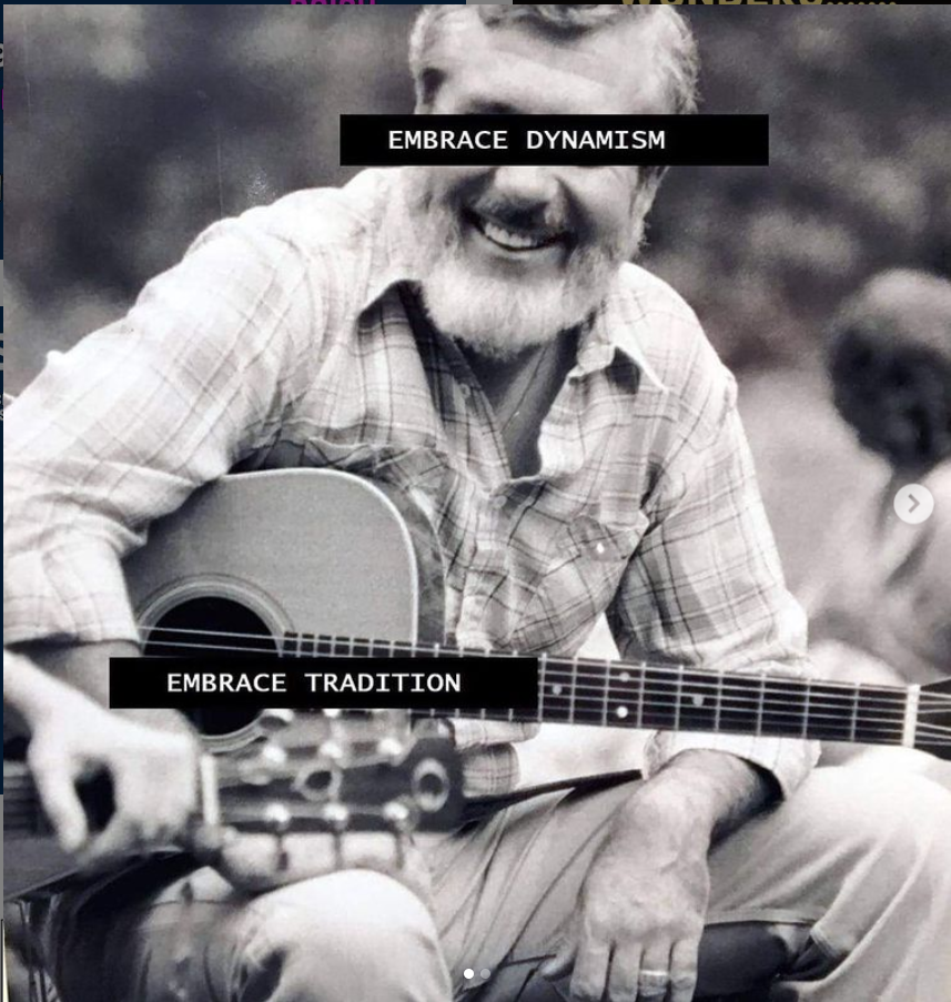 """black and white photo of Barre Toelken (full body; seated and holding an acoustic guitar) with the phrase """"embrace dynamism"""" over his face, and the phrase """"embrace tradition"""" over the guitar."""